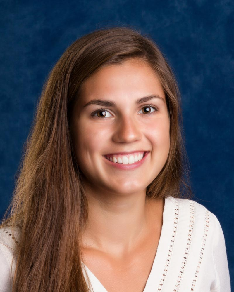 Kirah smiles after Invisalign Teen treatment by board certified orthodontist Dr. Michele Bernardich.